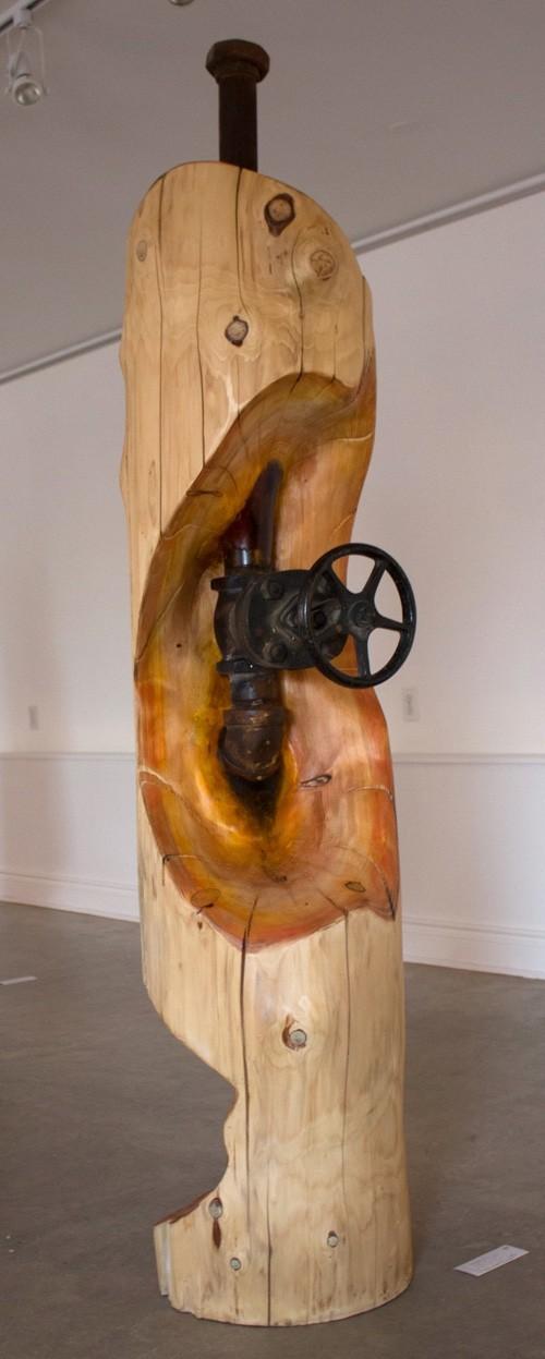Chauffage au bois?, de l'artiste Bernard Hamel, Sculpture, bois et acier, Création unique, dimension : 180 x 41 x 41 cm