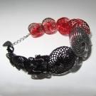Bracelet ESCARGOT, no 12, de l'artiste Sandrine Giraud, Paris, Ce bijou marie avec élégance la grâce et l'originalité des lignes résolument contemporaines. longueur de 8 pouces