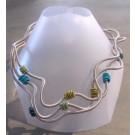 Collier PRIMAVERA, no 44, de l'artiste Sandrine Giraud, Paris, Ce bijou modulable, toujours original, marie avec élégance l'originalité des lignes résolument contemporaines.
