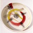 Plateau dentelle, no 16, de l'artiste Nancy Lavigueur, en semi-porcelaine, dimension : 12 pouces de diamètre, pièce vendue à l'unité, vue a