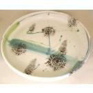 Plateau dentelle, no 17, de l'artiste Nancy Lavigueur, en semi-porcelaine, dimension : 12 pouces de diamètre, pièce vendue à l'unité