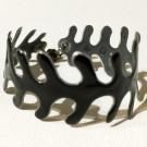 Bracelet Algue 1 rang (noir), no 51, Molusk, Longueur 5.75 pouces, Bijou aquatique souple et léger fait de PVC coloré qui épouse la forme du corps à la manière d'un tatouage, vue 1