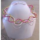 Collier Liane, no 36, de l'artiste Sandrine Giraud, Paris, Ce bijou modulable, toujours original, marie avec élégance la grâce des perles avec l'originalité des lignes résolument contemporaines.