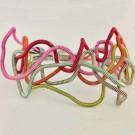 Bracelet LIANE, no 37, de l'artiste Sandrine Giraud, Paris, Ce bijou modulable marie avec élégance la grâce et l'originalité des lignes résolument contemporaines.